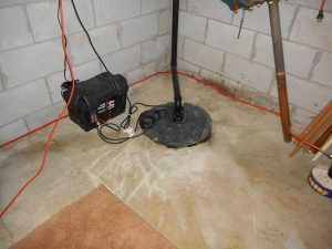 Emergency backup sump pump connected to backup battery