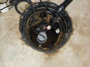 Emergency backup sump pump installed above original pump