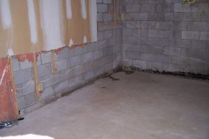 Leaking block foundation walls discovered in previously finished area